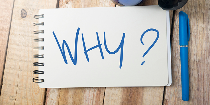 A notepad with 'why?' written on it