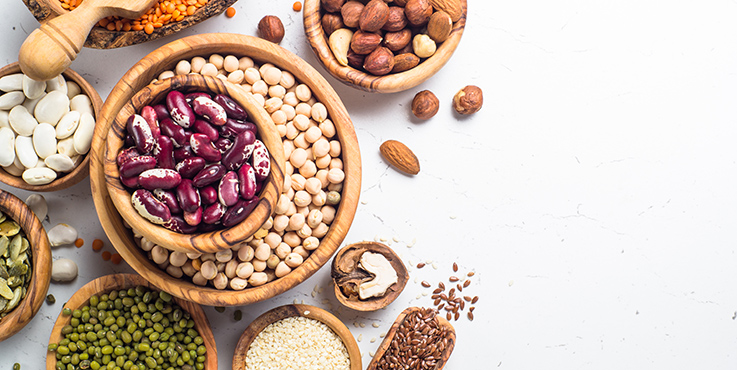 non-meat protein sources in bowls. Chickpeas, lentils, nuts, beans