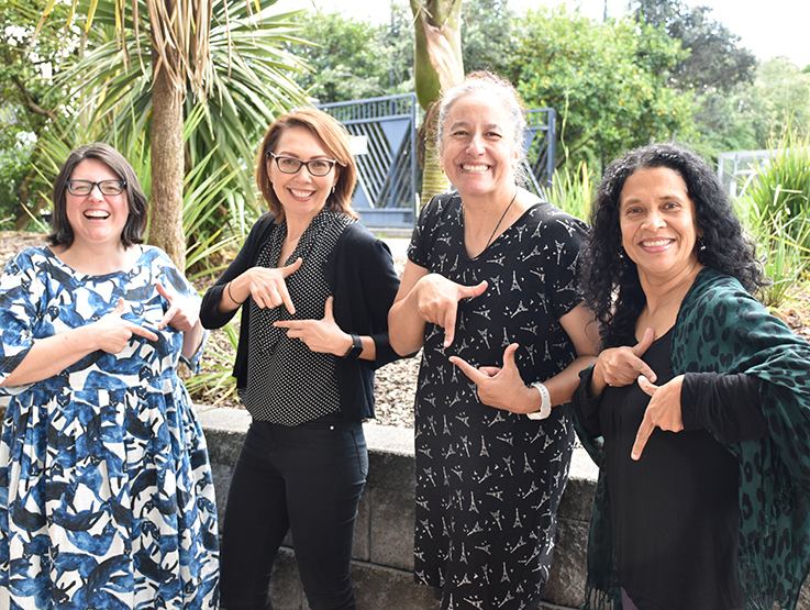 Heart Foundation researchers making heart symbol