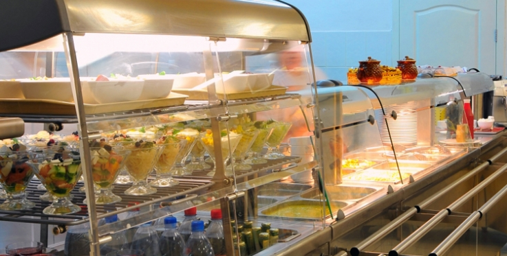 Healthy canteen food in display cabinet.