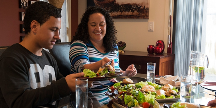 Family eating healthy food at table