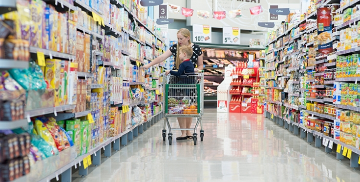 Woman in supermarket with child