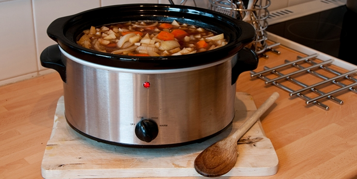 A slow cooker with food inside