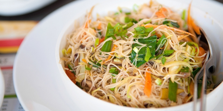 vermicelli noodles cooked into a meal in a bowl