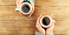Two holds holding coffee cups