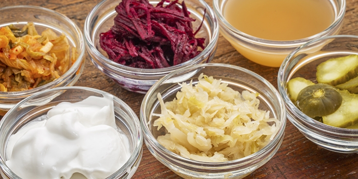 Fermented foods in bowls including pickles, beetroot
