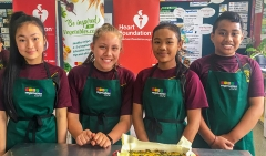 Four students in classroom with baked frittata they've made