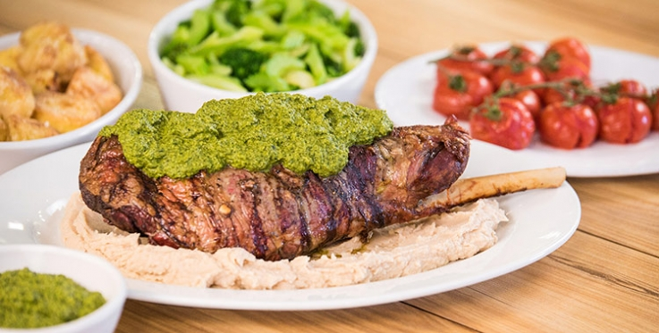 bbq leg of lamb with healthy green sauce and butter bean puree