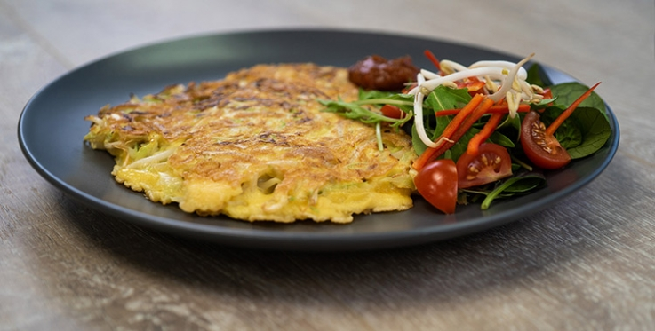 vegetable fritters with salad and relish