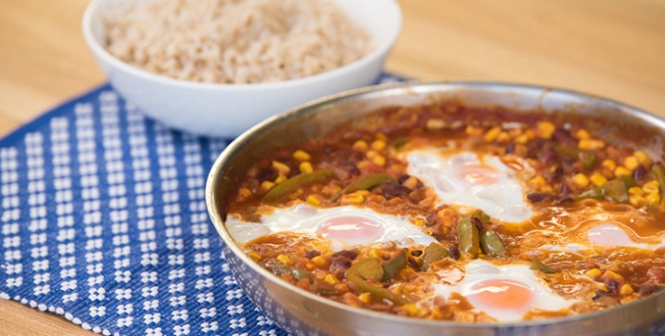 Eggs poached in chili beans with vegetables