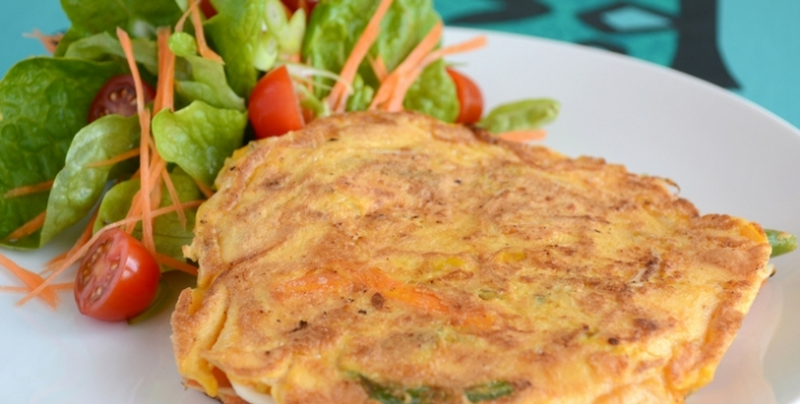 egg foo young served with a side salad