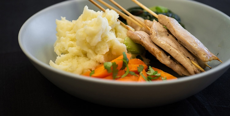 grilled chicken on skewers with steamed vegetables