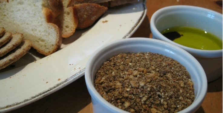 Moroccan dukkah served with olive and sliced bread