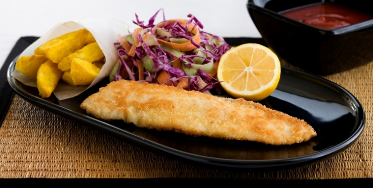 fish and chips with red cabbage coleslaw and sliced lemon