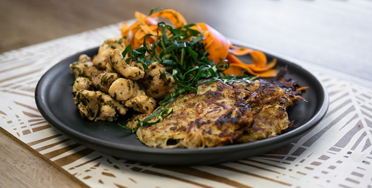 Pan fried chicken, carrot salad and potato rosti