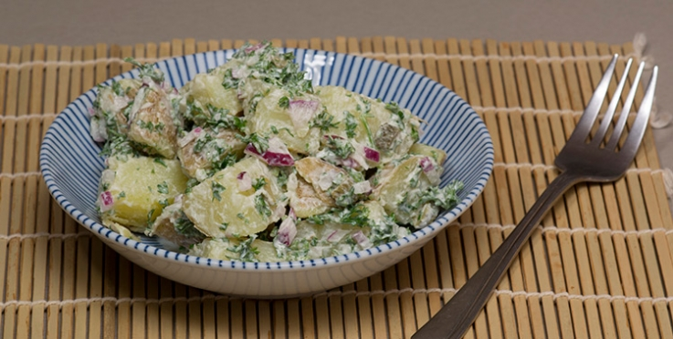 potato salad with gherkins and red onion