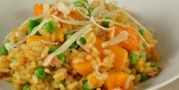 pumpkin risotto with peas and grated cheese