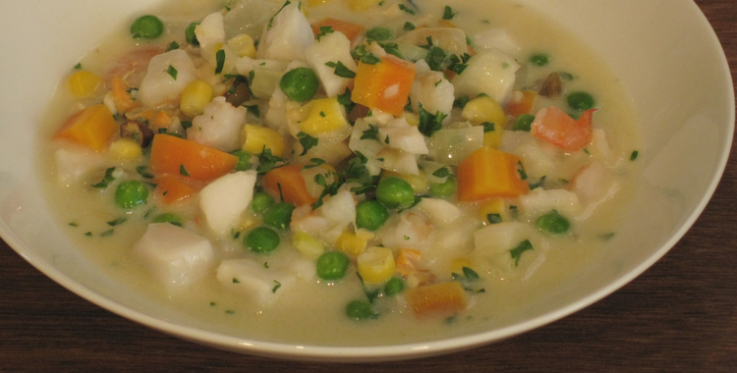 seafood chowder with carrots, corn and peas