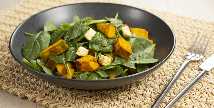Warm pumpkin salad with spinach and feta