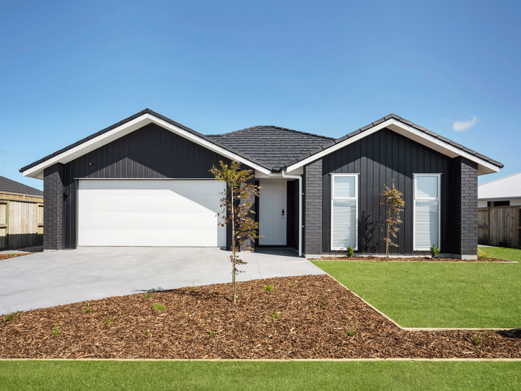 Lottery No.125 prize home in Taupo. Grey single floor house with large garage.