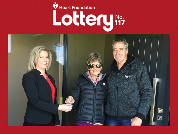 Lottery No.117 winners outside their new home