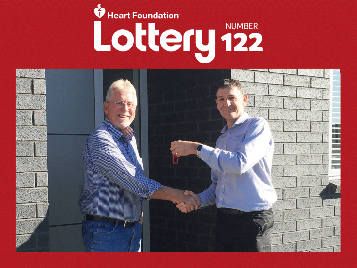 Lottery No.122 winner Jeff standing by his house
