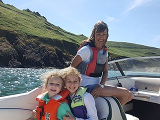 Denise and her grandchildren enjoying a day on the water