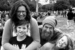 Jo pictured with her husband and two boys